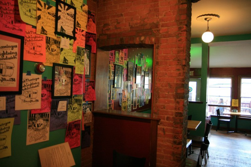 Gig flyers adorn the walls at Cafe Ollie