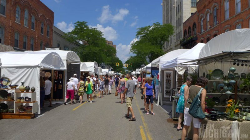 Folks enjoying the The Guild Summer Art fair on Main St.