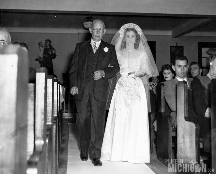 Betty and Albert Brown walking down the aisle Wedding 1947