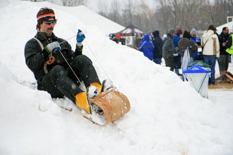 Sledding on the snow hill at the beer fest