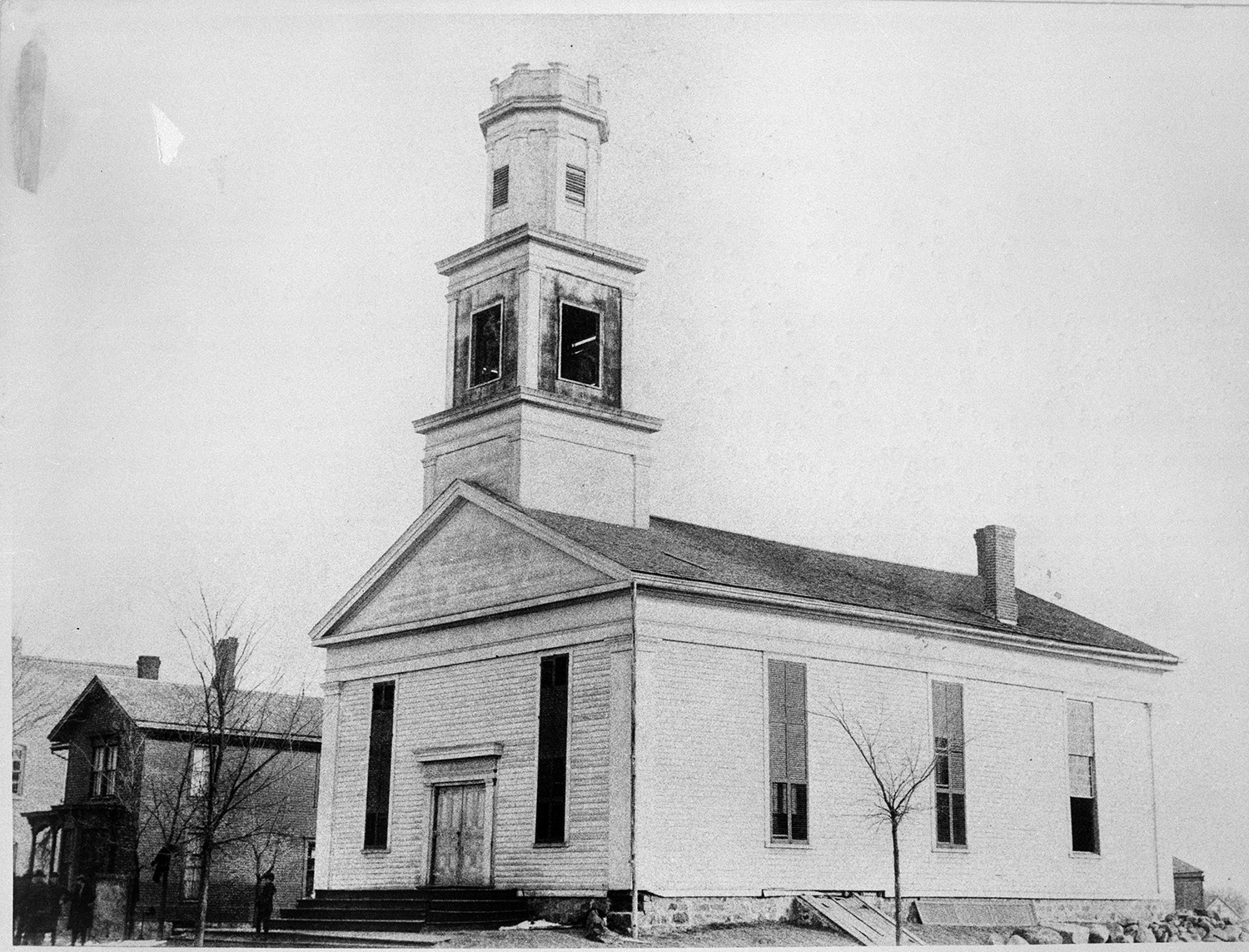 "The Methodist church at Ann Arbor and Henry Streets, 1857-1899""The Methodist Episcopal Church was built in 1837 on the corner of S. Ann Arbor and Henry Street. The house alongside to the north was the parsonage. Photo coutesy of the Saline Area Historical Society"