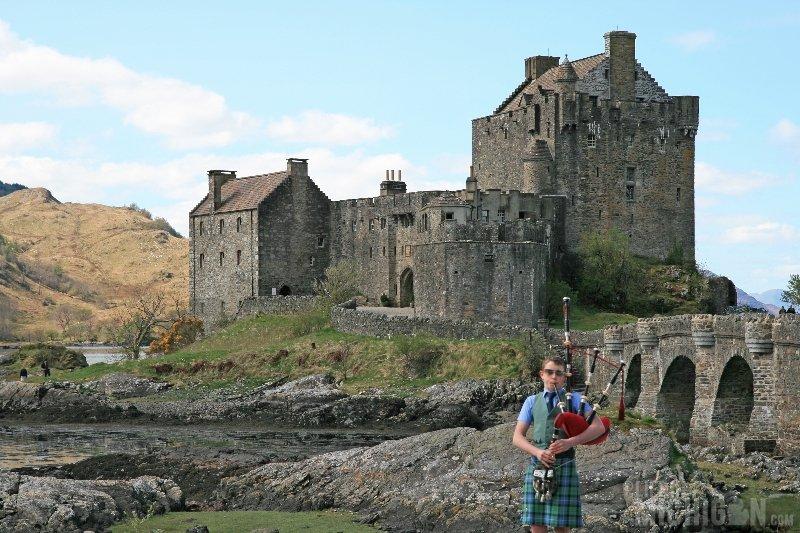Eilean Donan Castle, Scotland with Bagpiper