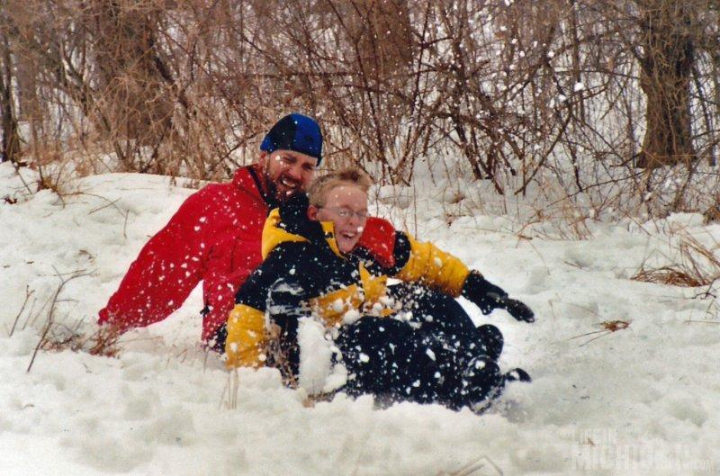Chuck and Shea sledding